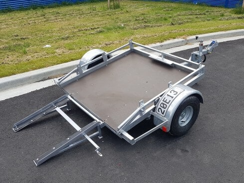 roller compactor trailer tilting view from rear