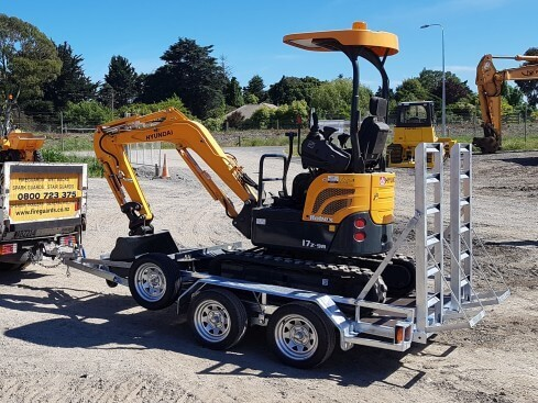 2.5 ton digger trailer with digger loaded on top