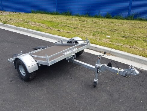 roller compactor trailer tilting view from front