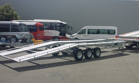 tri-axle car transporter hooked to a truck