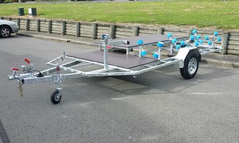 Custom jet-ski trailer with quadbike rack